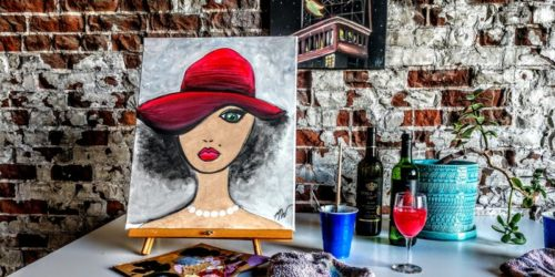 Pretty lady in hat painting